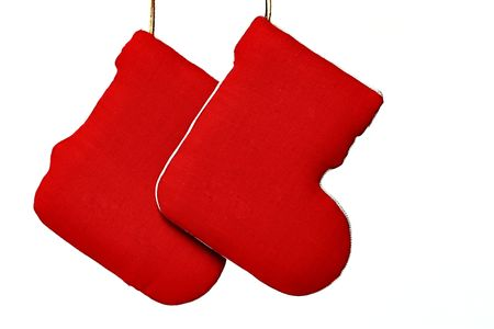 botas de navidad: Decorativas de Navidad botas rojas, fondo blanco  Foto de archivo