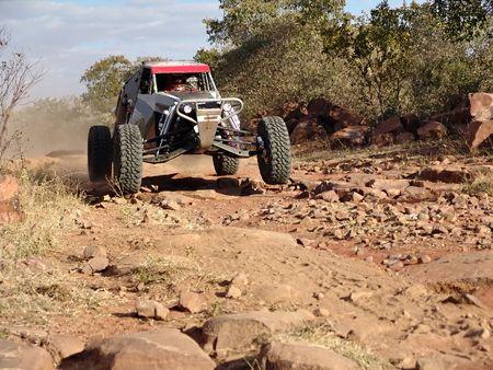 car sandmaster racing in kalahari desert photo