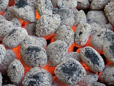 pyre: barbeque charcoal briquettes burning on the grill Stock Photo