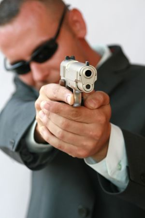 security man: young men with chromed pistol Stock Photo