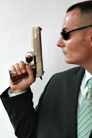 a watchman: young men with chromed pistol Stock Photo