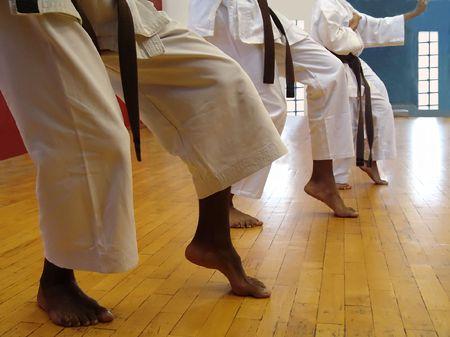 Group of karate men doing a kata