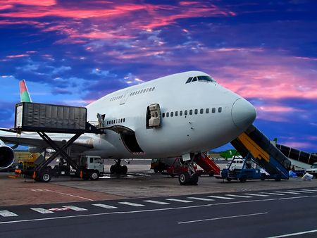 loaded: Jumbo Jet on the ground, getting loaded Stock Photo