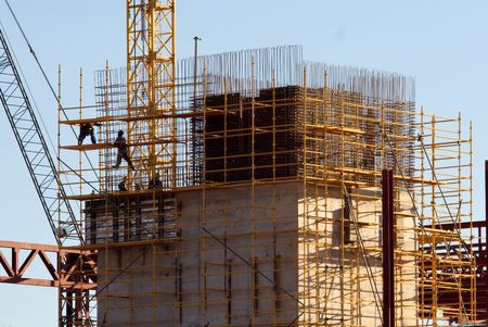 construction workers climbed on scaffolding, skyscraper new structure Stock Photo - 733802