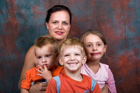 proud grandmother of three, surrounded by the grandchildren Stock Photo - 824306
