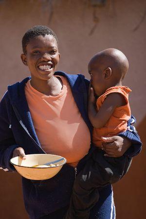 彼の目に涙を浮かべてアフリカの子供の肖像画。ボツワナ、アフリカ。 写真素材