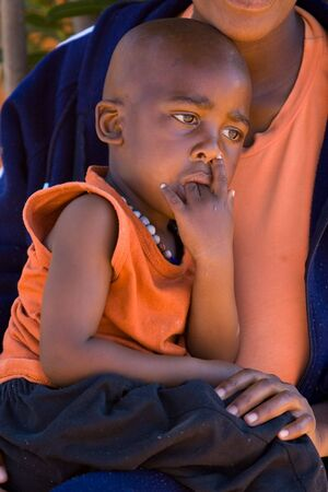 poor people: portrait of an African child with tears in his eyes. Africa, Botswana. Stock Photo
