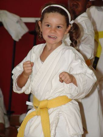 Small karate girl training in the dojo. No posing the pics are from a real training session.