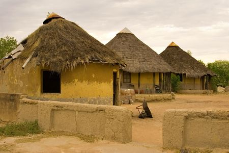 African village traditional huts, at the sunset, poverty, kgotla ( house of the chiefs ), Botswana, Africa