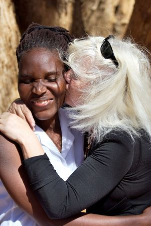 Caucasian woman with African girl, interracial couple