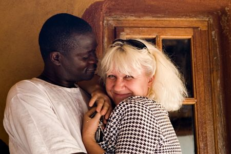 happy interracial couple, African American man with mid age Caucasian woman photo