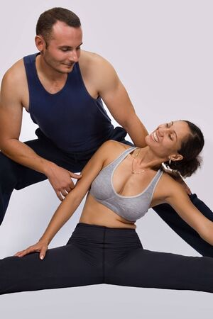 Caucasian male and colored African American girl, fitness training, sports series photo