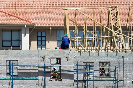 climbed: construction workers climbed on scaffolding, house new structure Stock Photo
