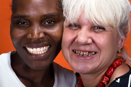 Dentistry nice smile hey, Caucasian and African American woman teeth compare. photo