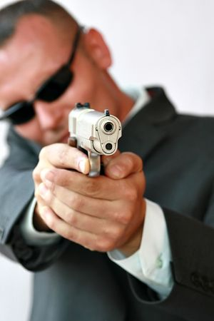 young men with chromed pistol, security concept series photo