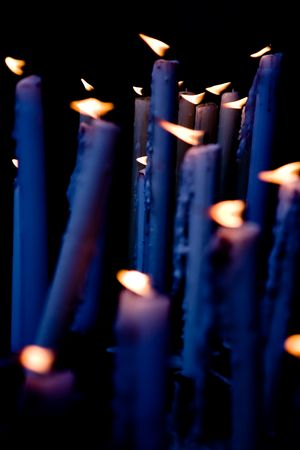 Candles blue tint applied, burning in the altar of the church. Stock Photo
