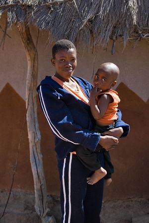 single parent african mother and child portrait. Africa, Botswana. photo