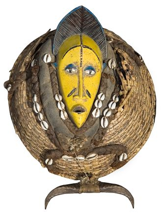 Traditional african mask, handmade from wood, shells, horns, straw, rope, woven, looks very old photo