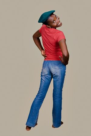 Young woman Zimbabwe, wearing casual clothing, blue jeans,\ red shirt
