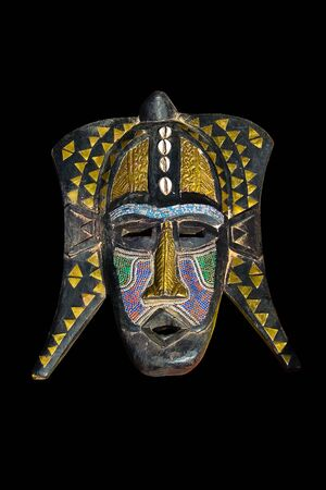 Traditional african mask, handmade from wood, shells, painted ,looks very old photo