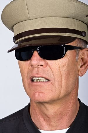 authoritative: German senior  citizen with an army hat, sunglasses, people diversity series