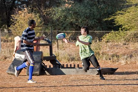 rugby players training with the ball on the field, sports series photo