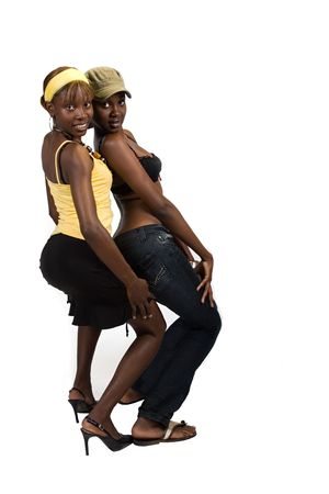 provocative couple: Two young African American girls, we are young beautiful and having fun, people diversity series Stock Photo