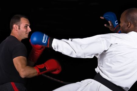 ultimate: Ultimate fighting, extreme sports, kickboxing versus karate, Caucasian and African American .