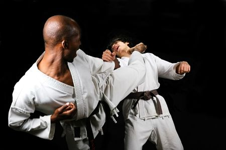 African American versus Caucasian karate fight(kumite) hayashi ha style, black and brown belt, sport series
