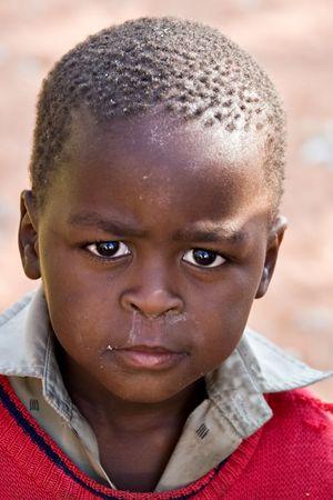Deprived African child, village near Kalahari desert, people diversity series