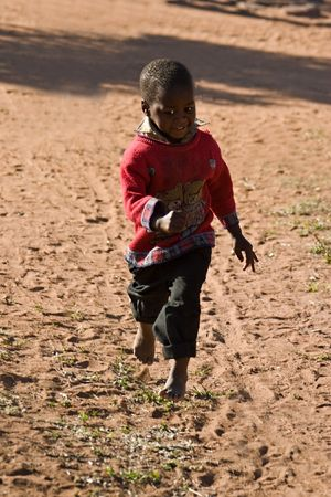 needy: Deprived African child, village near Kalahari desert, people diversity series