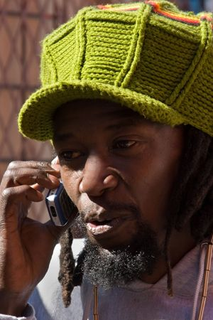 haile: Rastafarian man talking on the phone, people diversity series