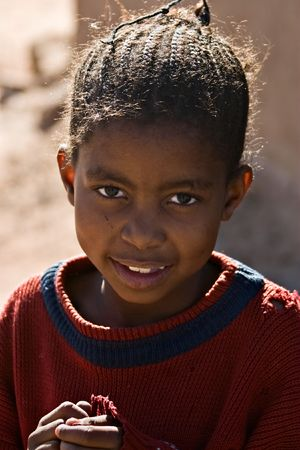 apartheid: Young girl portrait , social issues, poverty, village near Kalahari desert Stock Photo