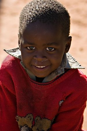 disadvantaged: Deprived African child, village near Kalahari desert, people diversity series