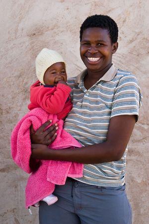 disadvantaged: African mother and child, village near Kalahari desert, people diversity series Stock Photo