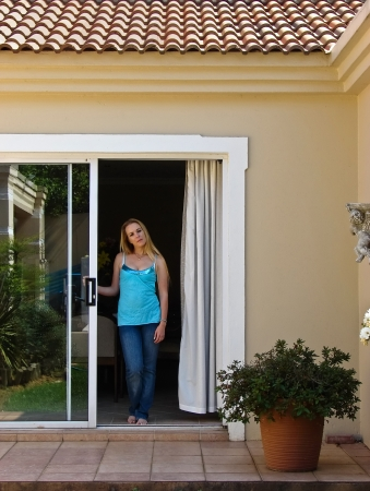 sliding door: Young Blonde woman waiting in the house, people diversity