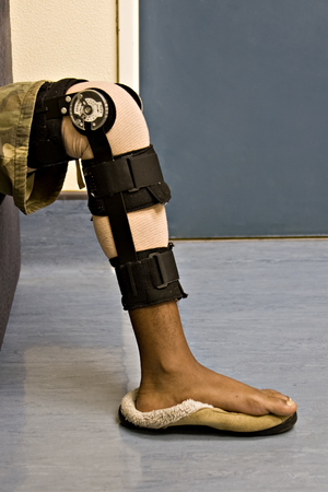 Young African American involved in a car accident, close up limb, healthcare series Stock Photo