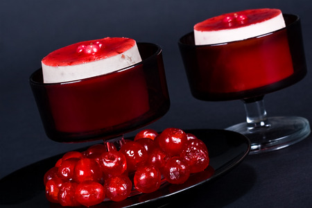 Luxury strawberry cheesecake with glassed cherries; food series; in IPTC status, instructions, you will find the recipe photo