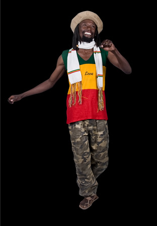 rasta hat: Isolated smiling rastafarian man,black background, people diversity series Stock Photo