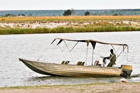 Okavango Delta: Tourist boat in Okavango delta.