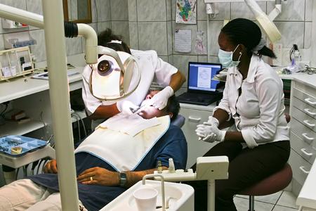 Dentist and nurse examining one patient, healthcare
