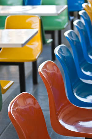 Multicolor plastic chairs in a kiddies restaurant photo