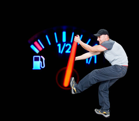 Angry man pulling the fuel needle, global warming conceptual, image not resized, gauge in macro mode, Stock Photo - 2113263