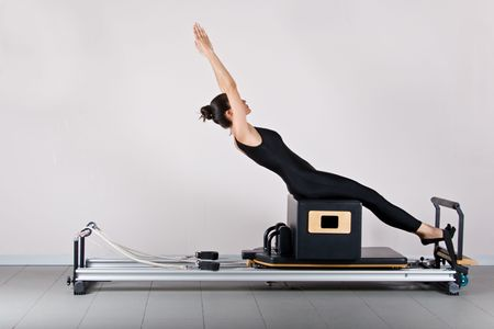 ABS on the short box position. Pilates gymnastics is a Germanic evolution of yoga, used by athletes to improve flexibility and body fitness and by chiropractors for patient recovery. photo