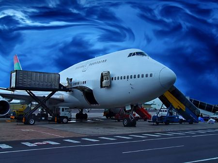 loading cargo: Jumbo Jet on the ground, getting loaded