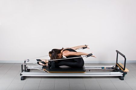 germanic: Back reach seated position. Pilates gymnastics is a Germanic evolution of yoga, used by athletes to improve flexibility and body fitness and by chiropractors for patient recovery.