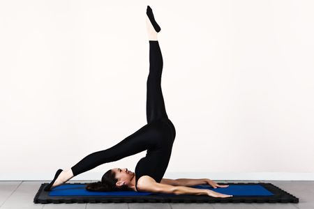 physical fitness: Balance control position, soft focus. Pilates gymnastics is a Germanic evolution of yoga, used by athletes to improve flexibility and body fitness and by chiropractors for patient recovery. Stock Photo