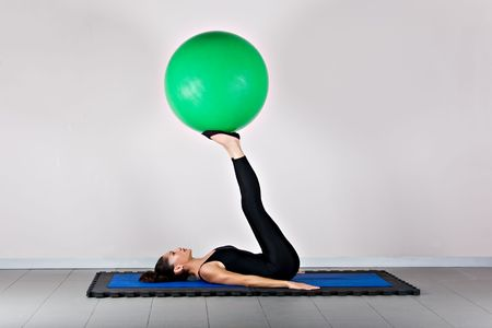recovery position: Control with ball position. Pilates gymnastics is a Germanic evolution of yoga, used by athletes to improve flexibility and body fitness and by chiropractors for patient recovery.