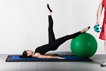 recovery position: Hip extension  with ball position. Pilates gymnastics is a Germanic evolution of yoga, used by athletes to improve flexibility and body fitness and by chiropractors for patient recovery.