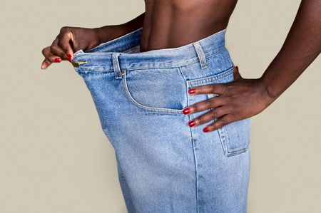 endure: African American woman with huge trousers, weight loss concept